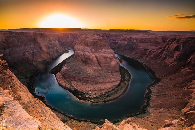 A blazing sunset over Horseshoe Bend ushers out a beautiful day in the southwest.